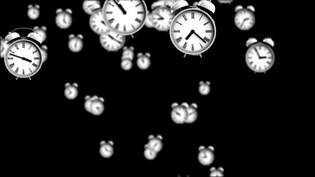 Alarm clocks falling down with depth of field effect video
