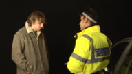Alcohol Breathalyser breath test for Drink Driving by Policeman video