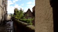 Alleyway  with a second shot of rooftops and chimneys video