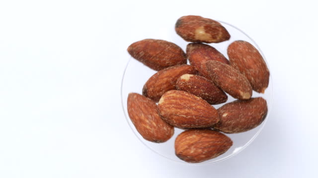 Almond rotate on white background video