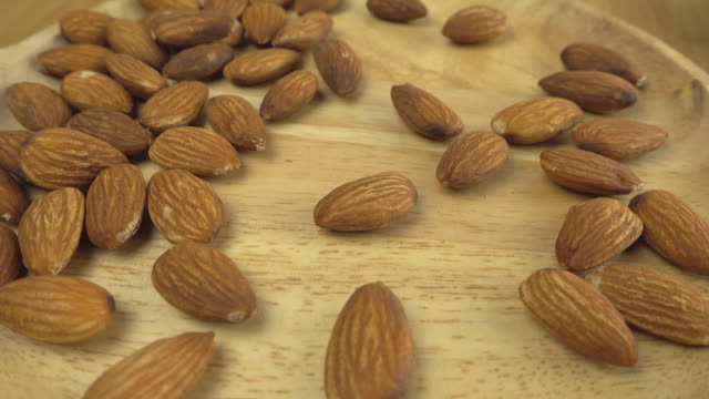 Almond rotating on a wooden plate video