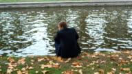 Alone Man Sits On The Bank video