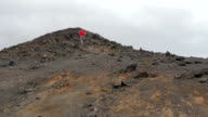 Alone runner runs to the summit of the volcano video