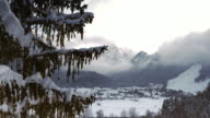 AERIAL Alpine valley covered in snow below the mountain tops video