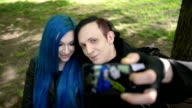 Alternative looking couple makes selfie video