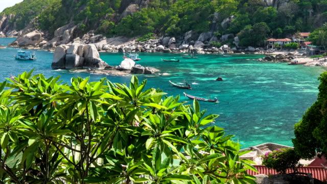 Amaing Tanote Bay with his beautiffull coral reef und huge granite blocks and longtail boat at anchor, Koh Tao, Thailand. video