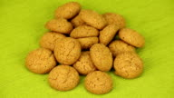 Amaretti biscuits rotate on a green background video