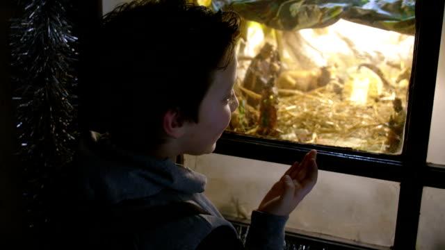 amazed child watching the nativity scene video