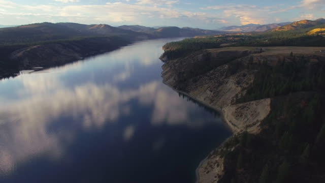 Amazing Aerial Over Lake Roosevelt, Washington at Sunset with Cloud Reflection video
