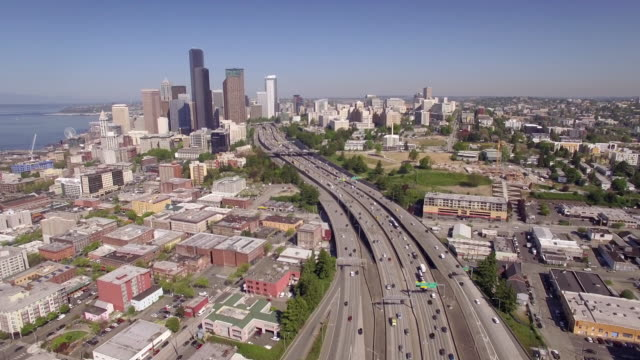 Amazing Aerial Pan of Downtown Seattle with Interstate Freeway and Financial Business Skyscraper Buildings in City Skyline video