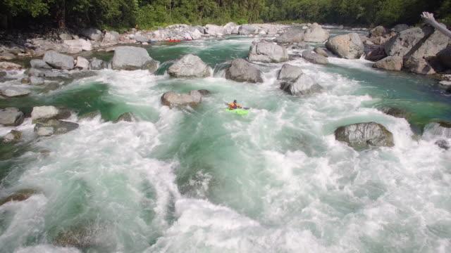 Amazing Aerial Shot of Man in Kayak Charging Down River Rapids video