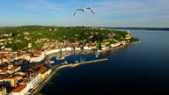 Amazing flight with birds over old city Piran, aerial view of old houses, roofs, fortress and the sea. Slovenia. video