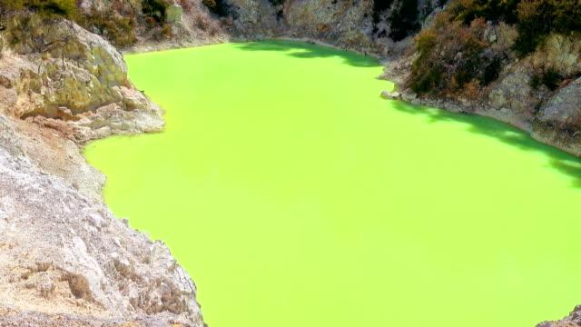 Amazing green colour of geothermal lake Devil's Bath. Wai-O-Tapu Geothermal Wonderland, Rotorua, New Zealand. video