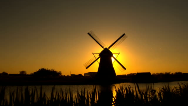 AERIAL: Amazing old traditional Dutch windmill at beautiful golden sunset video