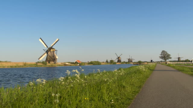 Amazing old vintage traditional windmills at rural village near river bank video