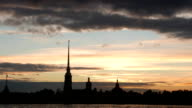Amazing sunset over Peter and Paul Fortress, dark spire silhouette video