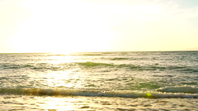Amazing Sunset Over Tropical Beach. Waves Roll up White Sand in SLOW MOTION. Luxury Resort Vacation video