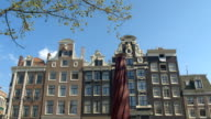 CLOSE UP: Amazing traditional buildings in canal district at sunny Amsterdam video