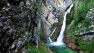 Amazing View of Waterfall Savica in Alps Mountains, deep clean blue water and green forest. Triglav National Park, Julian Alps, Bohinj valley, Slovenia. video