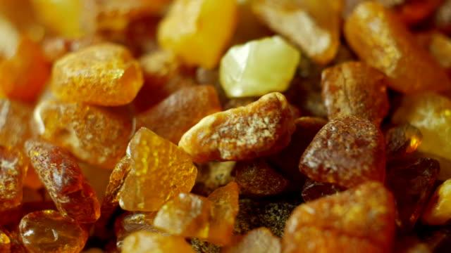 Amber stones on turn table video