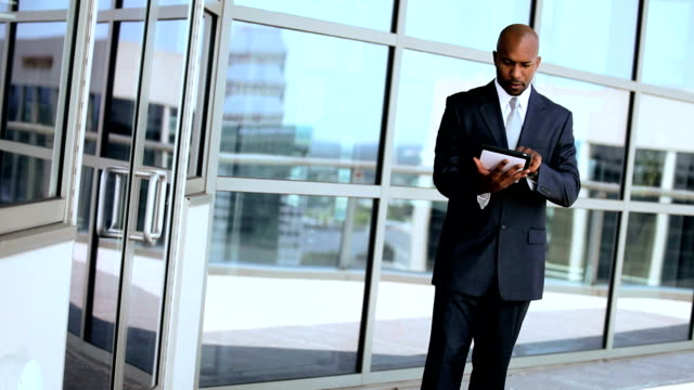 Ambitious Business Executives Using Wireless Tablet Outdoors video