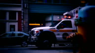Ambulance standing in front of building entance with siren blinking video