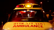 Ambulance with turned on siren at night video