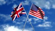 American and British flags waving together on sky video