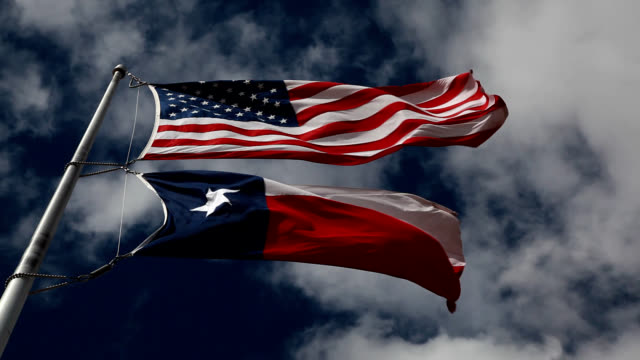 American and Texas Flags Waving in the Wind video