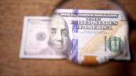 American currency one dollar bills through a magnifying glass video