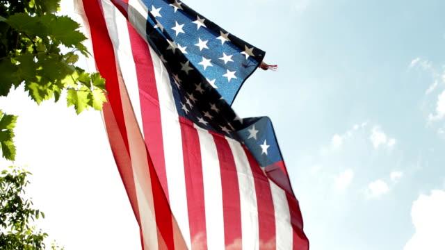 American flag against a blue sky video