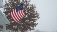 American Flag Blowing in Snow Storm video