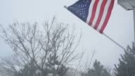 American Flag Blowing in Winter Storm video