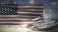 American flag on the sky with clouds and sun video