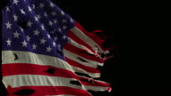 American Flag - slow motion. Torn and tattered waves in the wind. video
