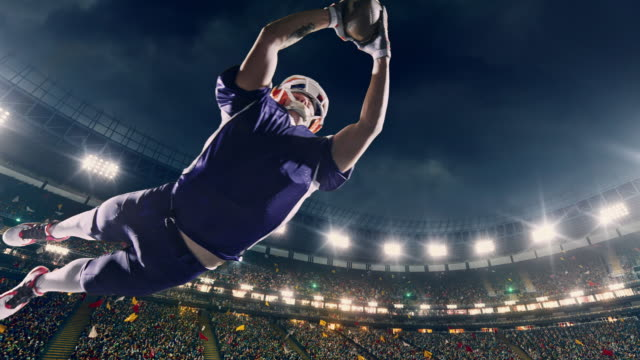 American football player jumps with a ball video