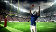 American football player triumphing with raised arms video