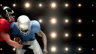 American football players against flashing lights video