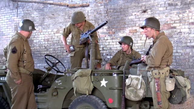 American World War 2 GIs wait in derelict building video