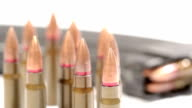 AK-47 ammunition. Defocus on a bunch of upright bullets. From the foremost to the rearmost. video