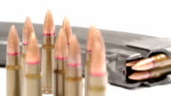 AK-47 ammunition. Defocus on a bunch of upright bullets. From the rearmost to the foremost. video