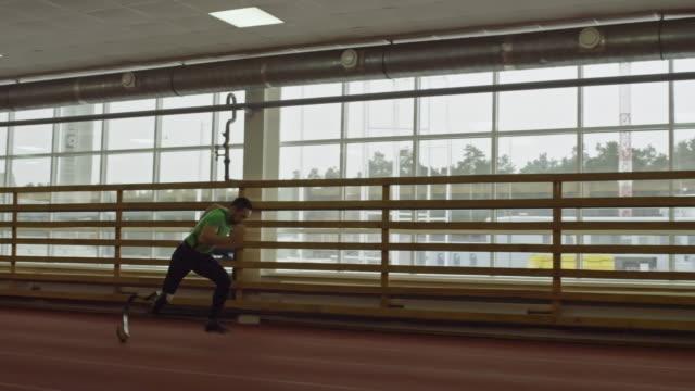 Amputee Athlete Exercising in Stadium video