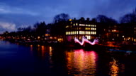 Amsterdam at night at the Amstel in the Netherlands video