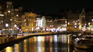 Amsterdam canal view by night with traffic video
