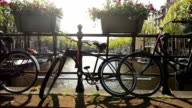 Amsterdam canal with bicycle, camera pan video