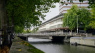 Amsterdam morning in center city - bridge with bicycles and cars on canal, Autumn, Netherlands video
