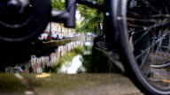 Amsterdam street with bicycles and cars on canal, Autumn, Netherlands video