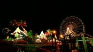 Amusement park at night with ferris wheel video