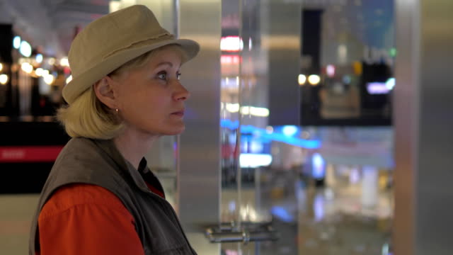 An Adult Woman Looks Around The Airport. video