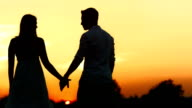 HD: An Affectionate Couple At Sunset video